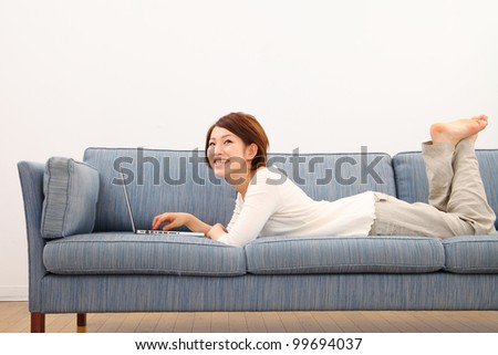 beautiful asian woman using laptop computer - stock photo
