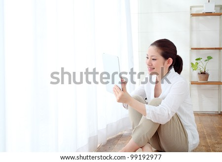 beautiful asian woman using tablet computer - stock photo