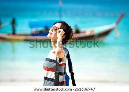 Beautiful asian woman vacation on beach of Thailand. - stock photo