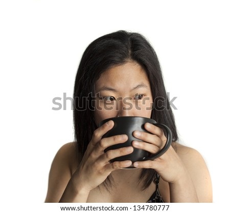 Beautiful Asian woman with brown hair and eyes with black coffee cup on a white background. - stock photo