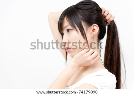 beautiful asian woman with ponytail hair style - stock photo