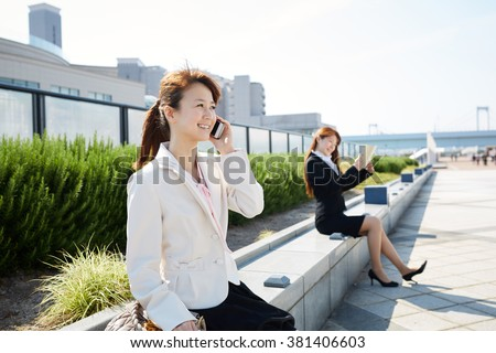Beautiful asian woman working in the business district  - stock photo