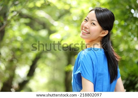 beautiful asian women in the forest - stock photo
