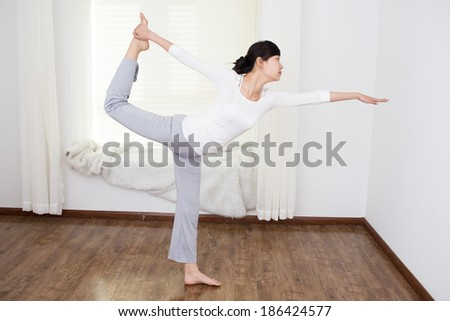 Beautiful Asian women to practice yoga in the room - stock photo