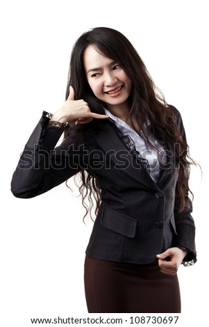 Beautiful Asian young business woman with phone hand sign on white background - stock photo