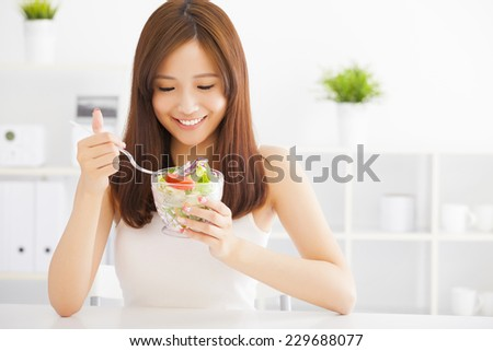 beautiful asian young woman eating healthy food - stock photo