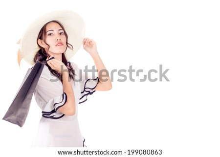 Beautiful asian young woman posing with shopping bags, isolated on white background - stock photo