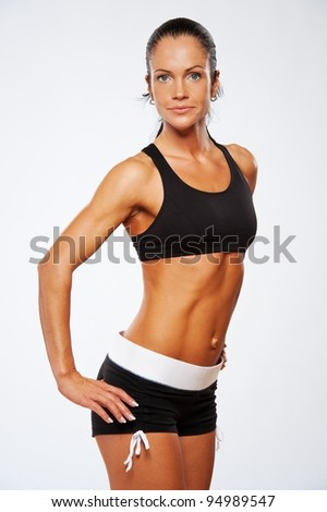 Beautiful athlete woman doing fitness exercise. - stock photo