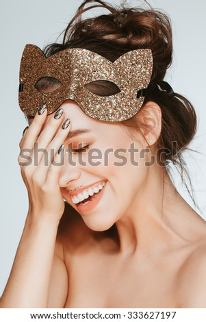 Beautiful attractive brunette model face closeup, facial expression of happiness, young woman smiling. - stock photo