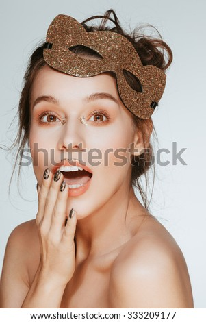 Beautiful attractive charming young brunette surprised woman portrait closeup in mask, nude natural fresh makeup. - stock photo