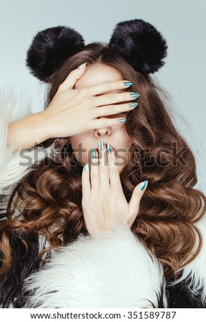 Beautiful attractive charming young caucasian girl with brown chocolate shiny hair posing in the studio. - stock photo