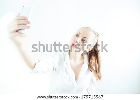 Beautiful/attractive/cute/sexy young girl/woman/lady doing duck face/ taking a photo of herself (white background,look at camera) - stock photo