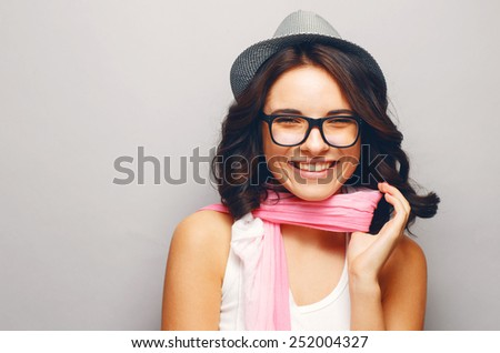 Beautiful attractive girl in a hat and glasses. - stock photo