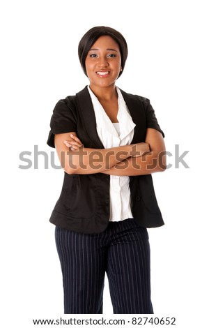 Beautiful attractive smiling corporate business woman standing with arms crossed, isolated. - stock photo