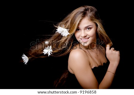 Beautiful attractive young  smiling girl with white flowers in her hair - stock photo