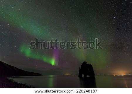 Beautiful aurora borealis, northern light at hvitserkur, Iceland  - stock photo