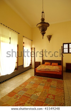 Beautiful authentic arabic bedroom in a traditional riad (guesthouse), Morocco - stock photo