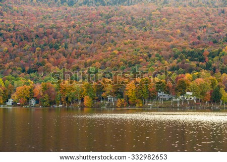 Beautiful autumn foliage and cabins in Vermont. - stock photo