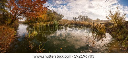Beautiful autumn landscape, sky reflection in water - stock photo
