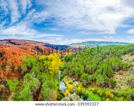 Beautiful autumn landscape with colorful forests and blue sky near Madrid in the autonomous community of Castilla y Leon, Spain - stock photo