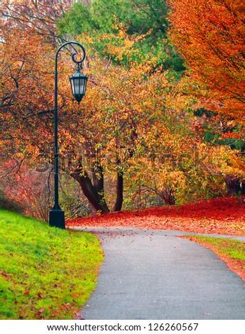Beautiful autumn landscape with street lantern - stock photo