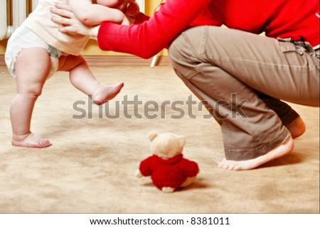 Beautiful baby and mother. Shot in a interior. - stock photo