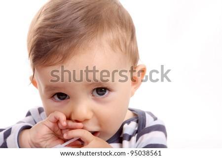 beautiful baby biting, baby studio photo - stock photo
