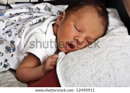 Beautiful baby boy sleeping - stock photo