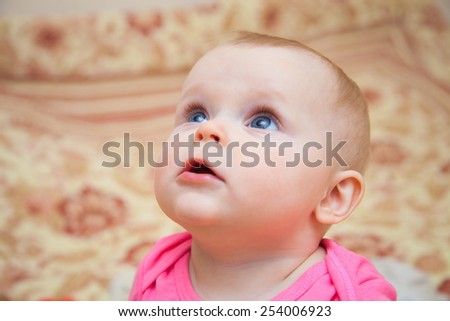Beautiful baby few months old portrait - stock photo