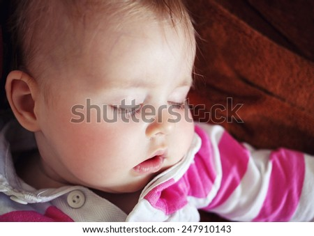 beautiful baby girl sleeping in bed - stock photo