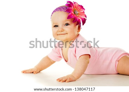 beautiful baby girl with a flower - stock photo