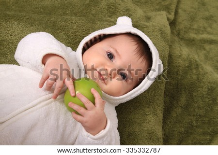 beautiful baby girl with green apple - stock photo