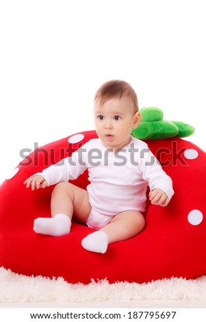beautiful baby in a child seat. isolated - stock photo