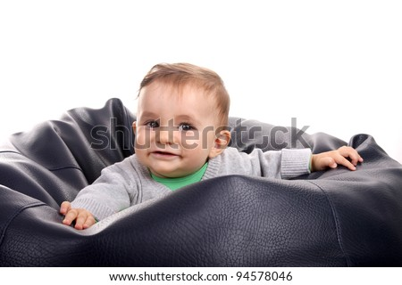 beautiful baby in a poof, studio photo - stock photo