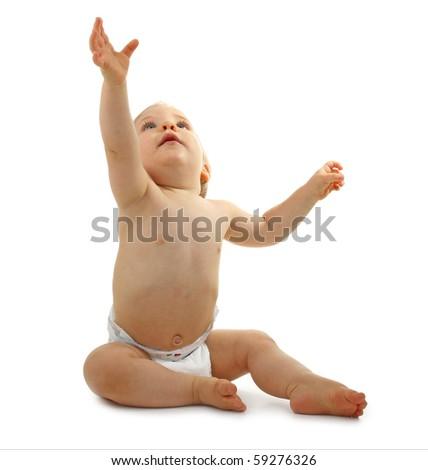 beautiful baby sitting on white background - stock photo