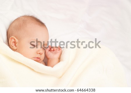 beautiful baby sleep on a white background - stock photo