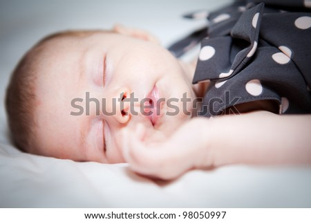 Beautiful baby sleeping - stock photo