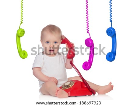 Beautiful baby with many telephones isolated on a white background - stock photo