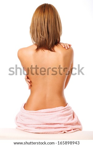 Beautiful back of a young woman after shower isolated  - stock photo