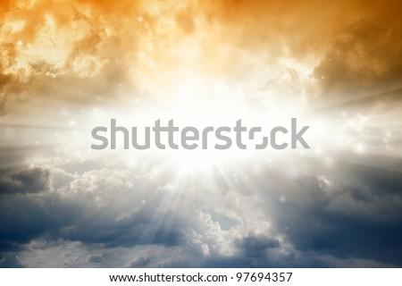 Beautiful background - bright sun in dark sky - stock photo
