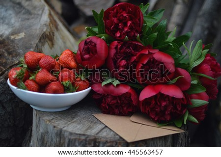 Beautiful background with red strawberry, purple flower and elegant necklace for a love letter. Top view. Space for text - stock photo