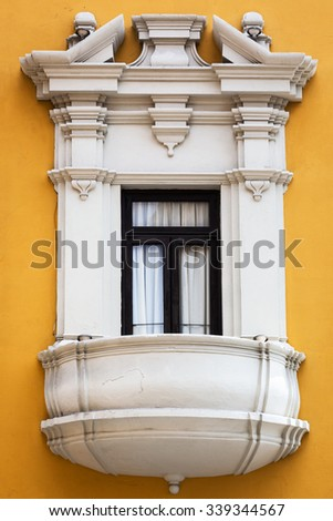 beautiful balcony window and yellow wall - stock photo