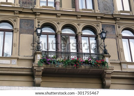 Beautiful Balcony with geraniums hang-downing on an old house, Vienna - stock photo