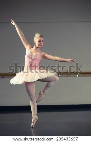 Beautiful ballerina dancing en pointe in the dance studio - stock photo
