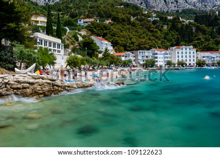 Beautiful Beach and Transparent Turquoise Adriatic Sea near Split, Croatia - stock photo