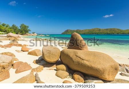 Beautiful beach Anse Boudin seen from the granite boulders, Praslin island, Seychelles.  - stock photo