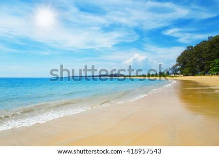 Beautiful beach blue sea wave summer sunny background - Leisure summer concept - stock photo