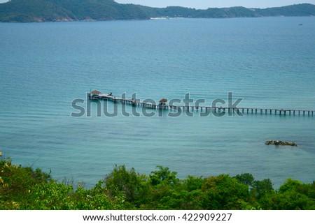 Beautiful beach view with long bridge - stock photo