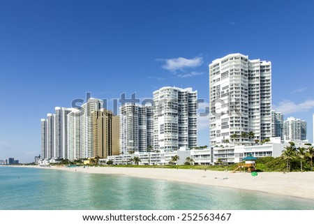 beautiful beach with condomiums and skyscraper in Sunny Islands - stock photo