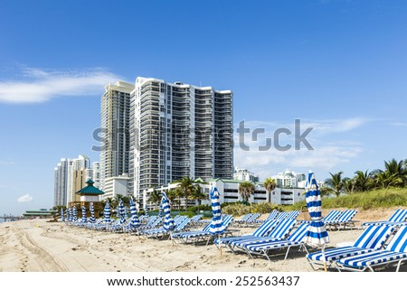 beautiful beach with condomiums and skyscraper in Sunny Islands, Miami - stock photo